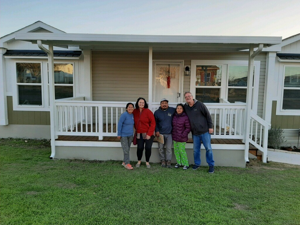 new homeowners outside house at lakeside crossing